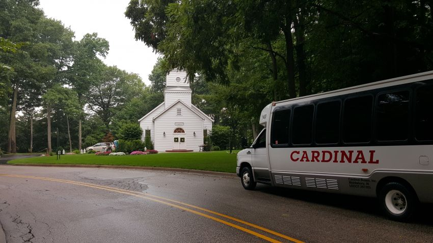 Cardinal Buses 24 passenger at church
